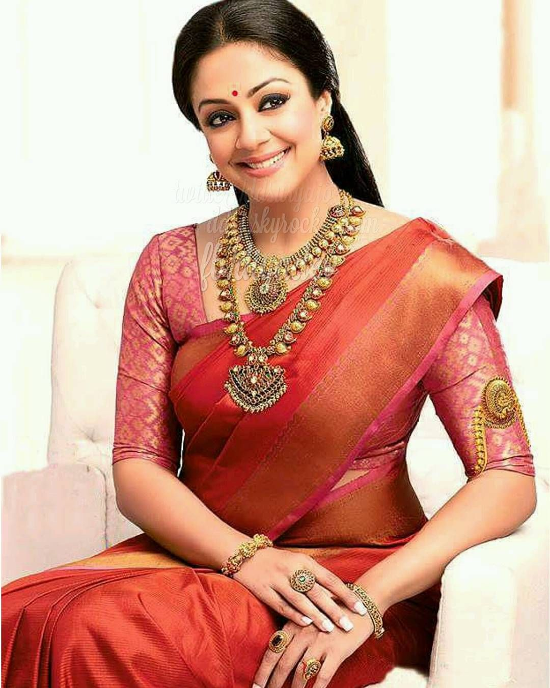 Jyothika in red saree