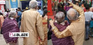 No age for romance; Older couple roaming hands, taking selfies in Durga Pooja