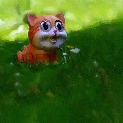 Happy Cat in a green meadow
