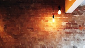 A Brick Wall with light bulbs in from of it