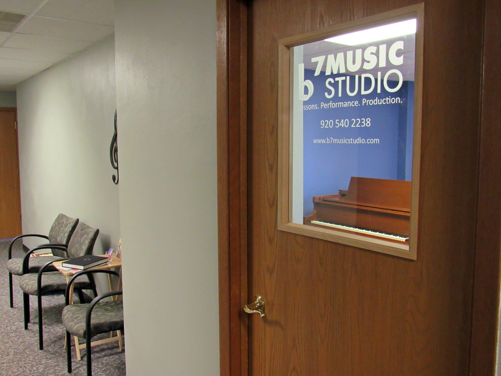 view of the door and waiting area to B7 Music Studio