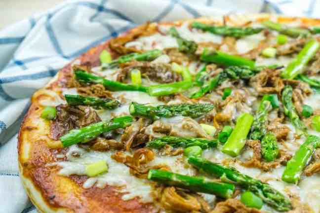 Use leftover pulled pork to make this BBQ Pulled Pork Pizza with Asparagus in just 20 minutes for a delicious, healthy dinner!
