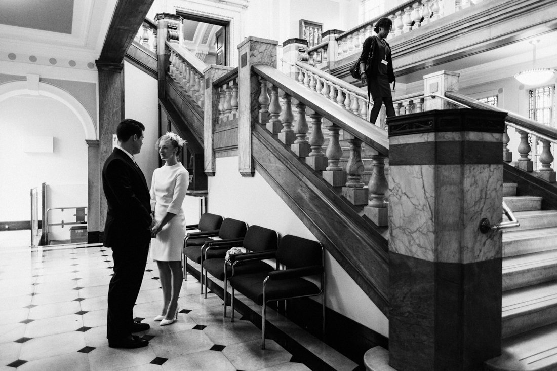 How to elope - the bride in short dress with the groom and a grand staircase - UK elopement photographer - London wedding photographer - Babb Photo