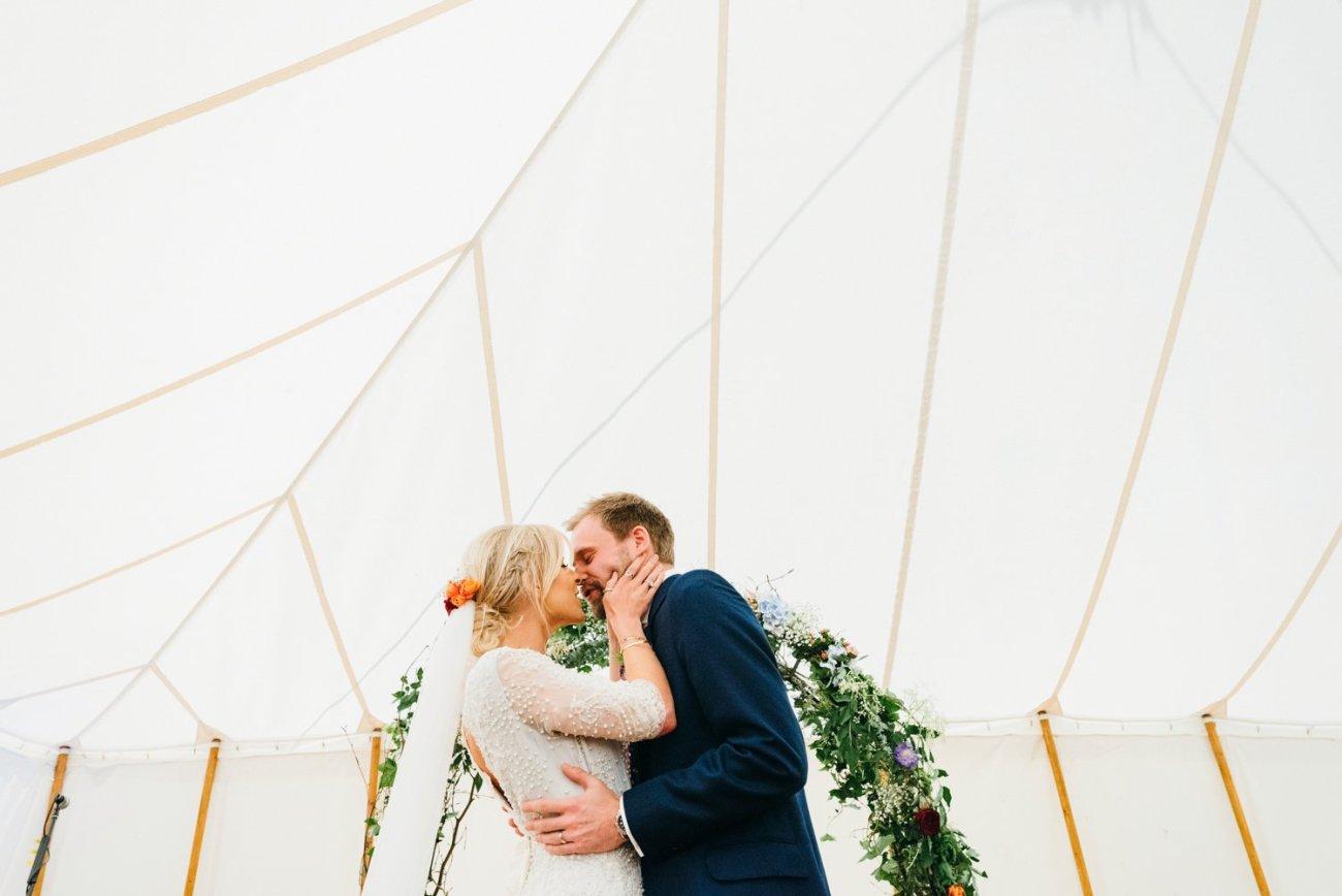 Emma Beaumont bride & groom kiss