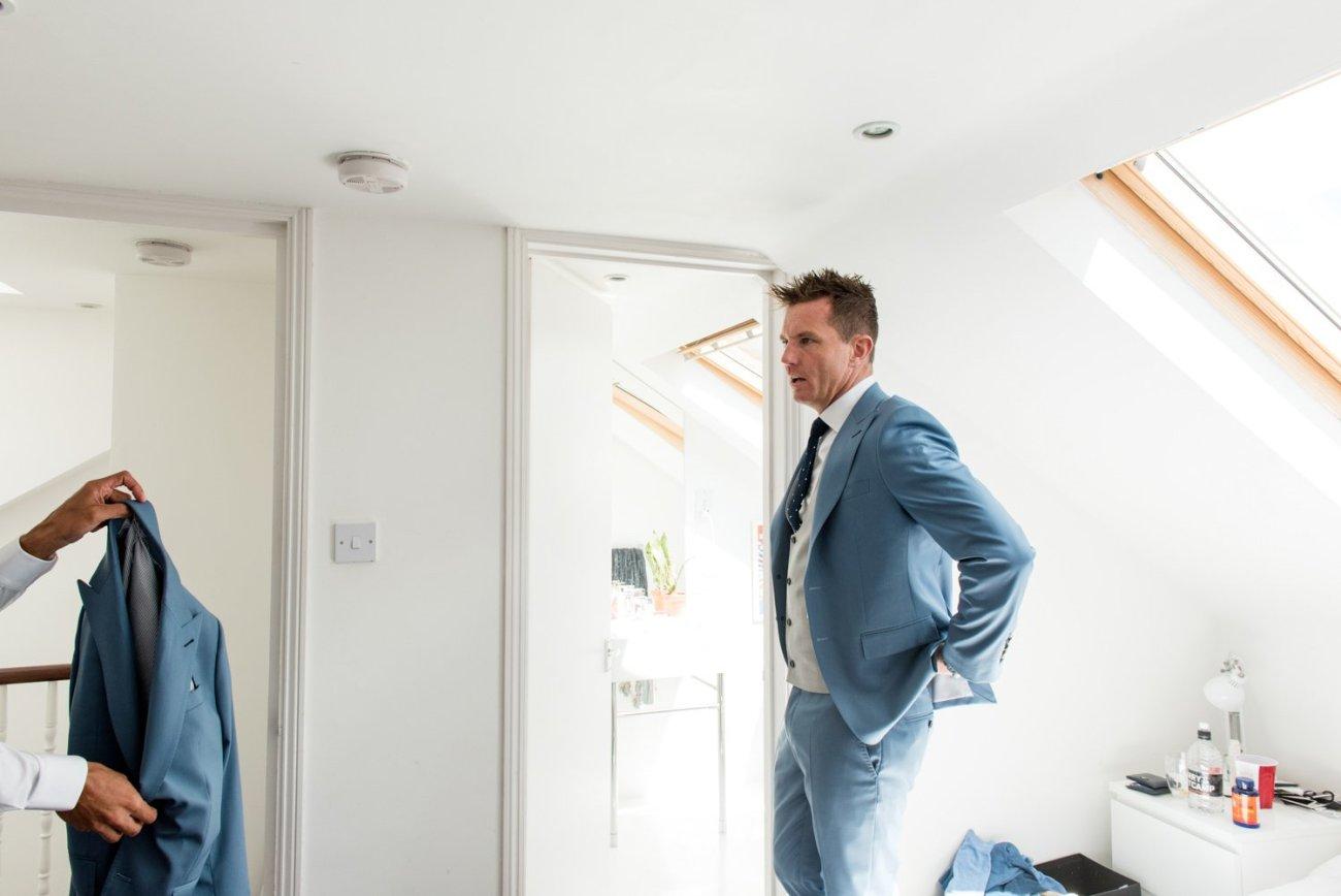 Groom wearing pastel blue suit documentary pre-wedding photography London