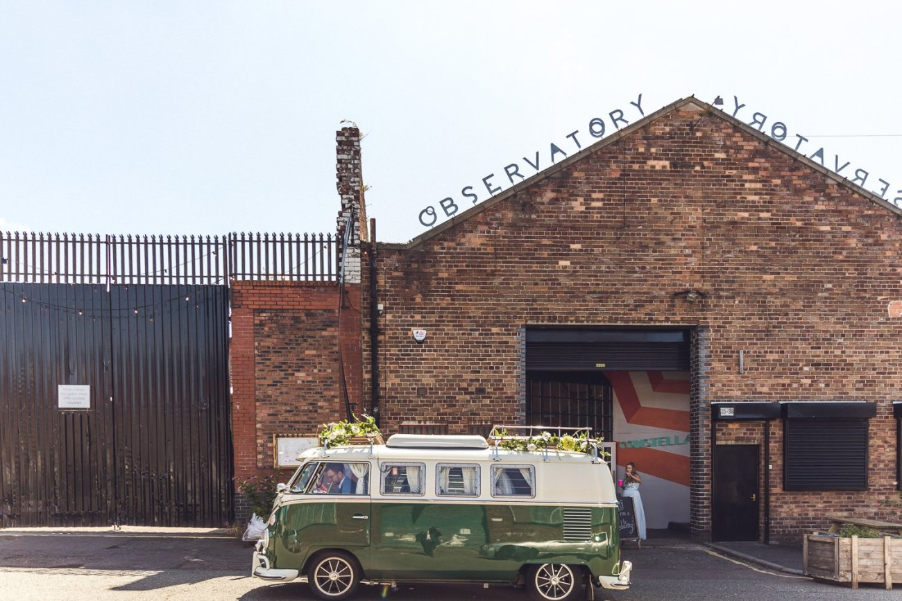 Green VW camper parked on urban street outside Constellations liverpool