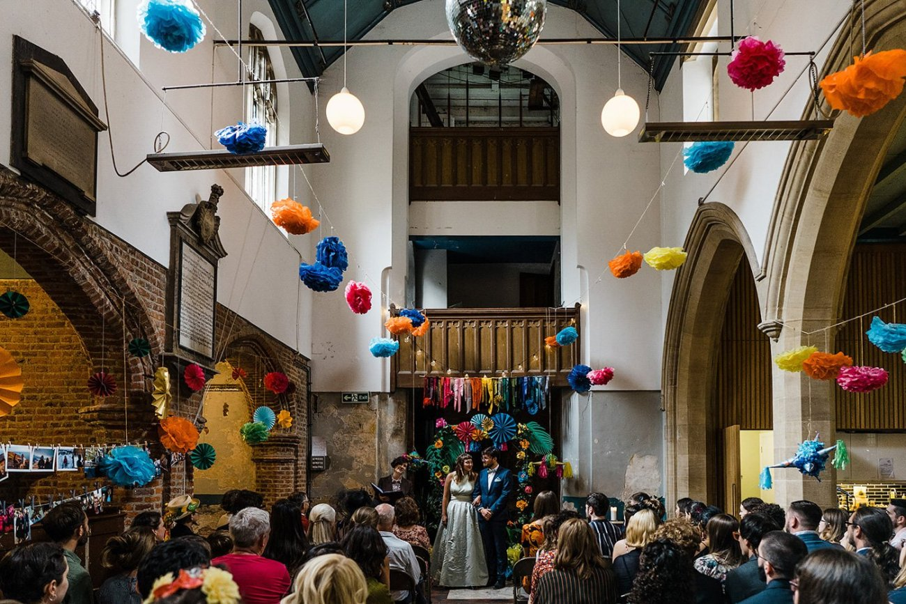 A wide shot of a humanist wedding ceremony at Stoke Newington Old Church