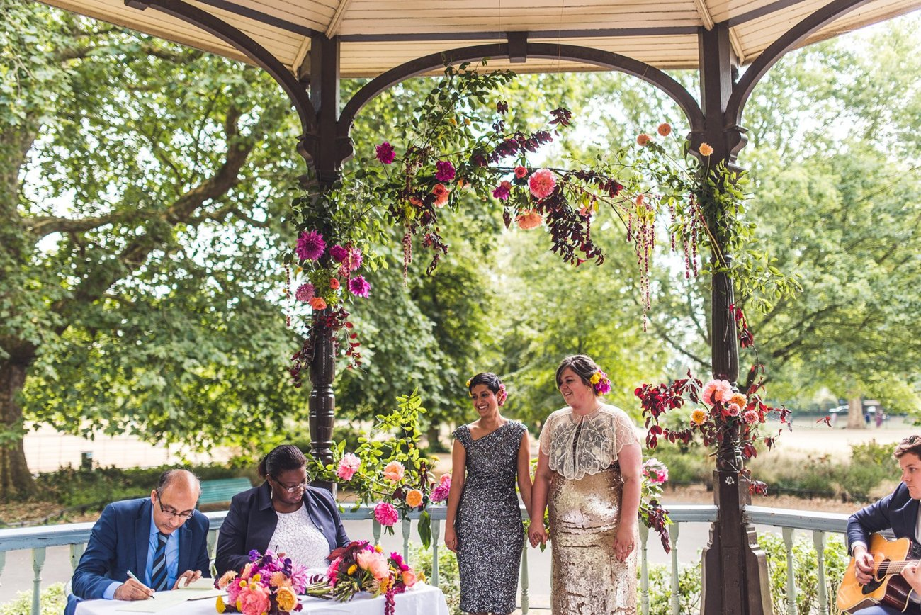 Two brides at band stand wedding intimate socially distant wedding
