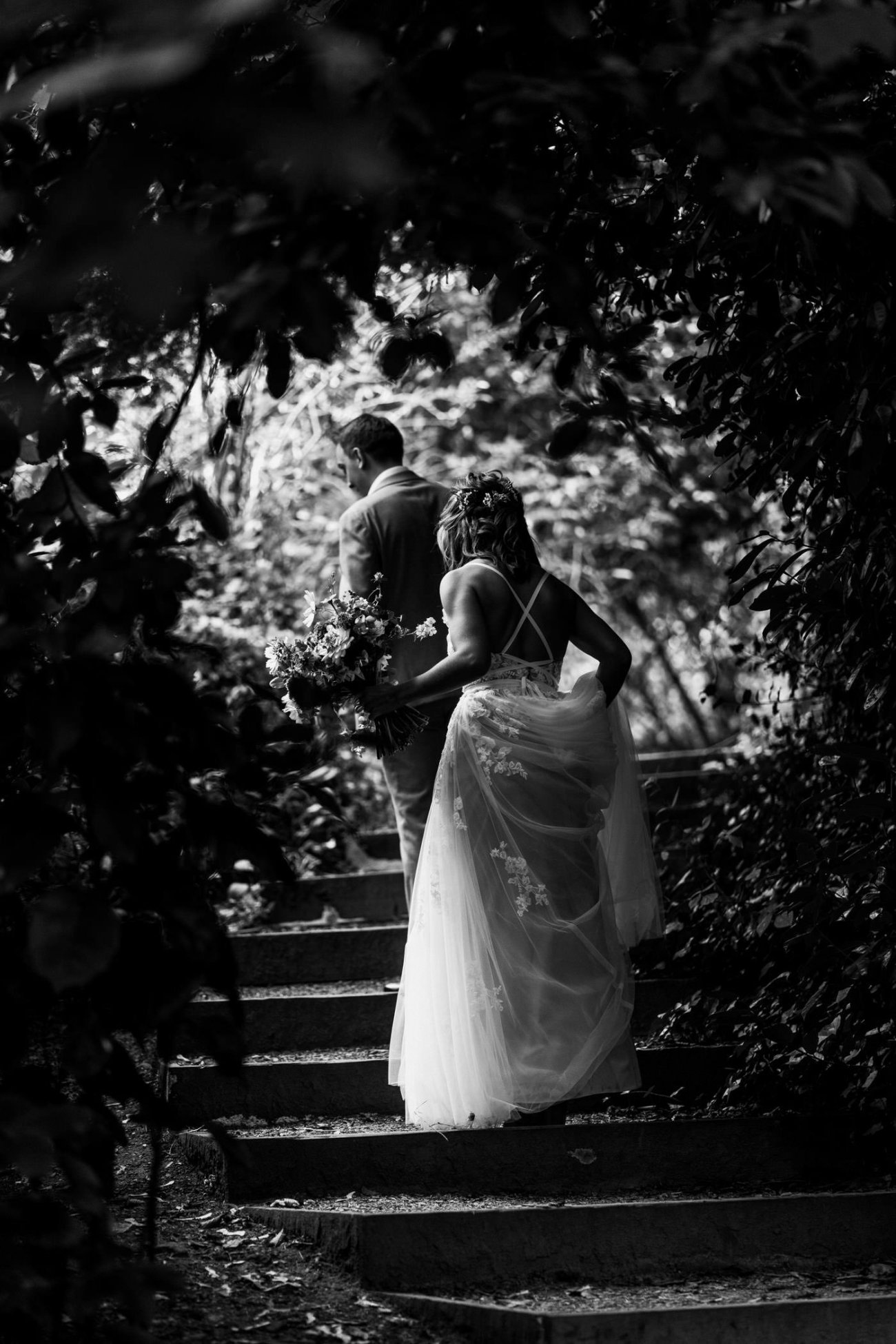 Black and white picture of bride and groom walking up stairs at Stephens House & Gardens wedding