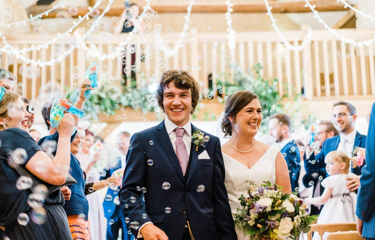 Couple leave wedding in shower of bubbles instead of confetti
