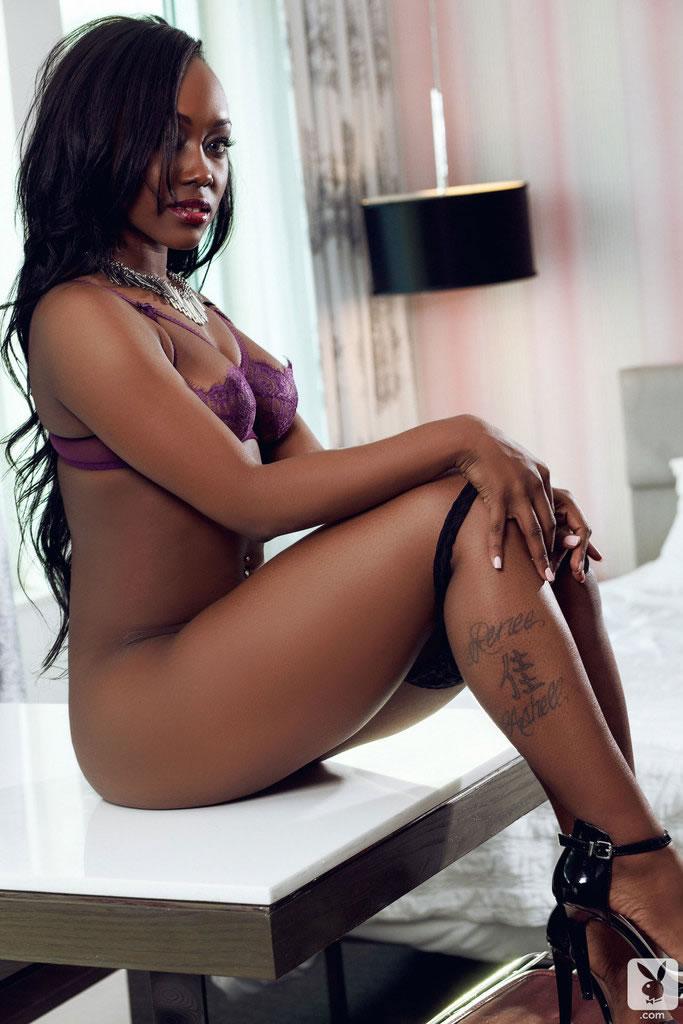 Hot ebony babe Lovelyn taking off her purple lingerie
