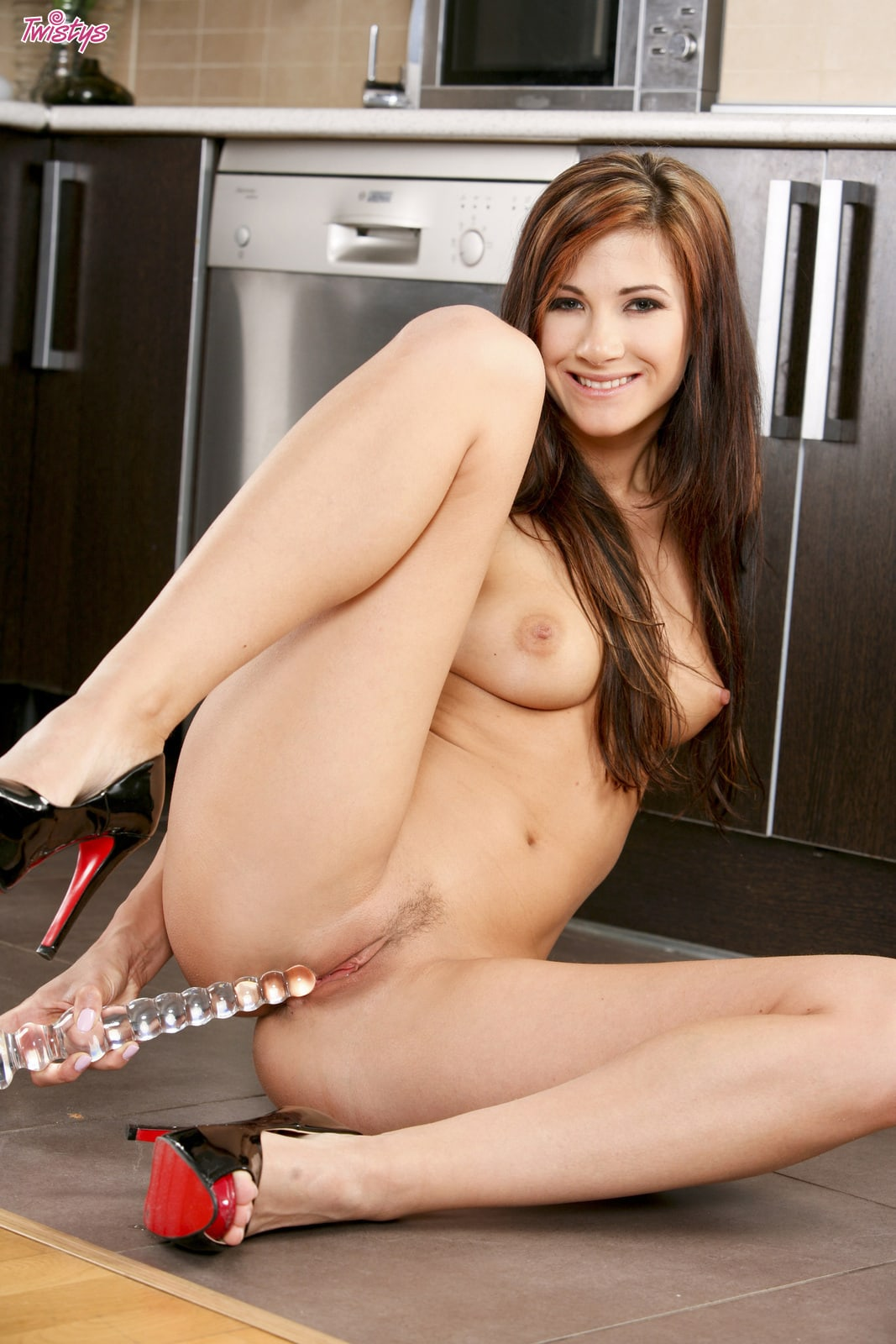 Lauren Crist stripping in the kitchen and playing with a dildo