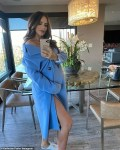 Katharine Mcphee shows off bump in blue coat