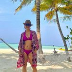 Salma Hayek,54 in Magenta bikini