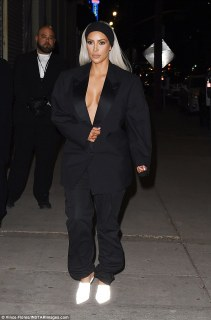 Kim Kardashian attend Create & Cultivate event Braless