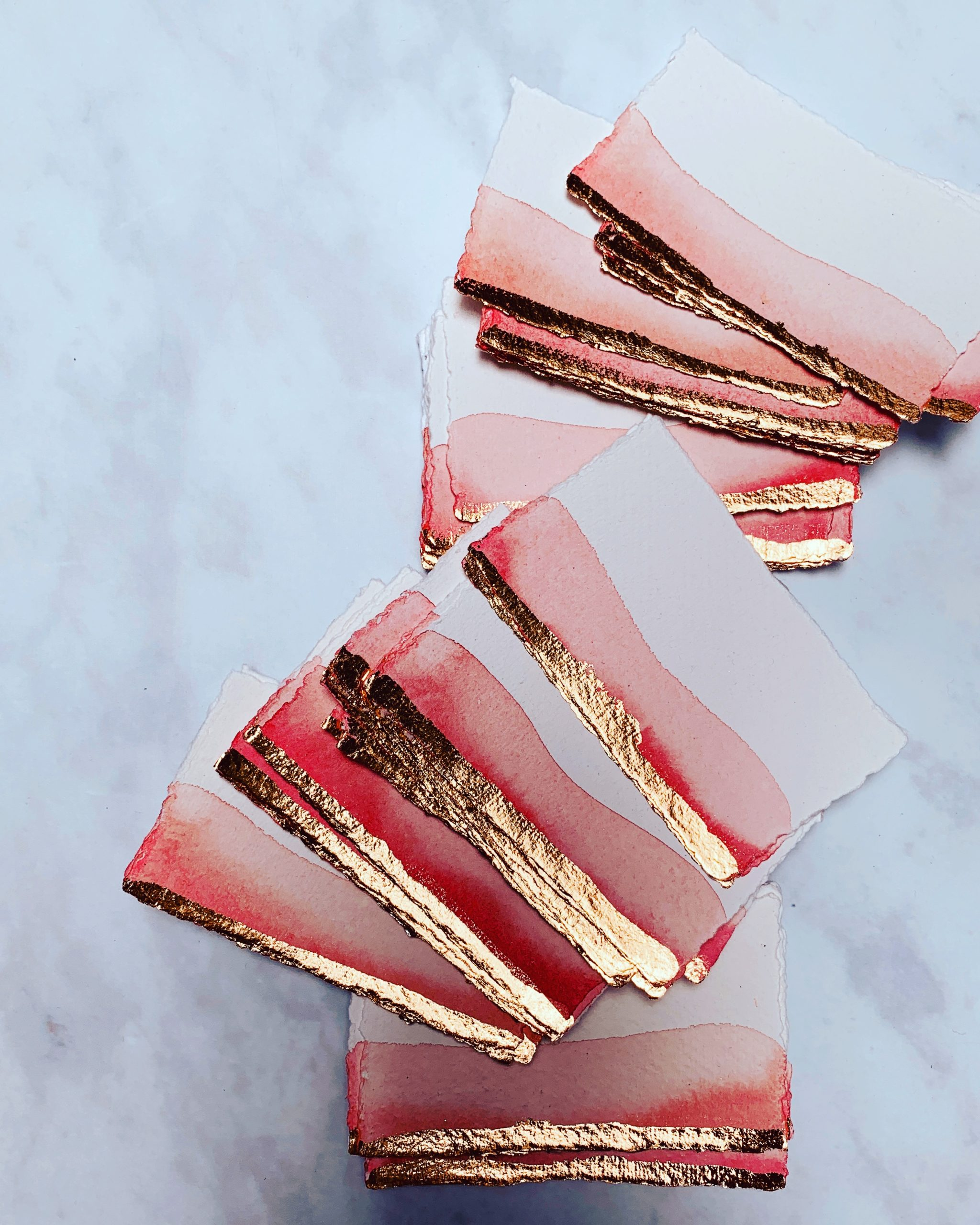 Blush place cards with gold leaf handmade paper