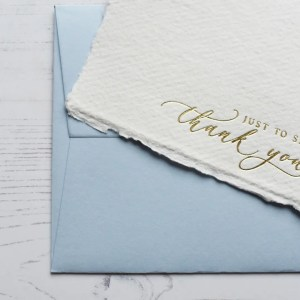 Gold foil handmade paper thank you cards with pale blue envelope