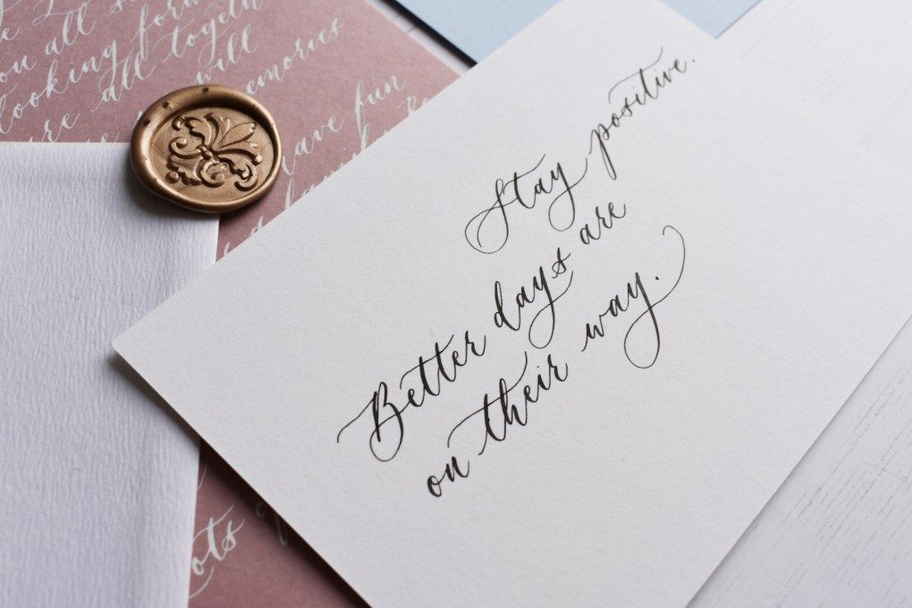 White personalised handwritten note with black calligraphy ink