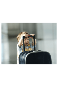 baby pushing a suitcase