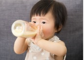 baby drinking from bottle-cropped