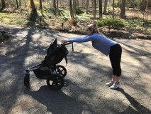 woman stetching with her jogging stroller