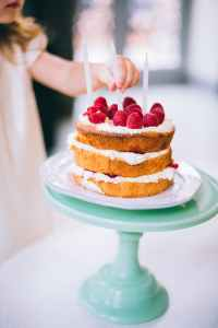 birthday cake with raspberries on top, children's birthday party