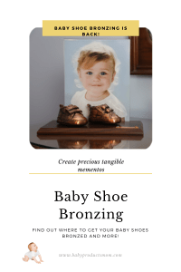 mounted bronzed baby shoes with photo of baby in the background