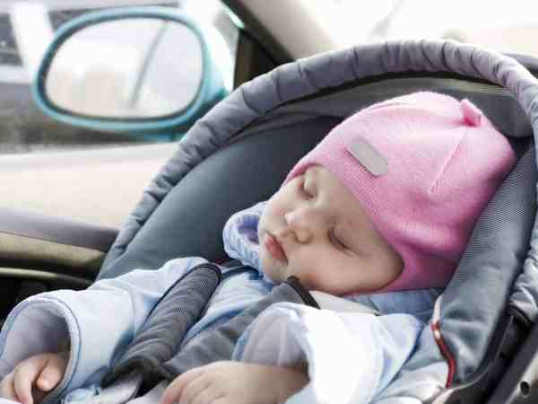 2825934 – little baby sleeping in a car in a child`s car seat