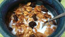 Granola with coconut milk in a bowl