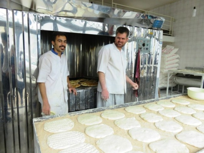 men making Persian bread in Qazvin Iran. Bread is very important in Persian cuisine and part of any Persian breakfast