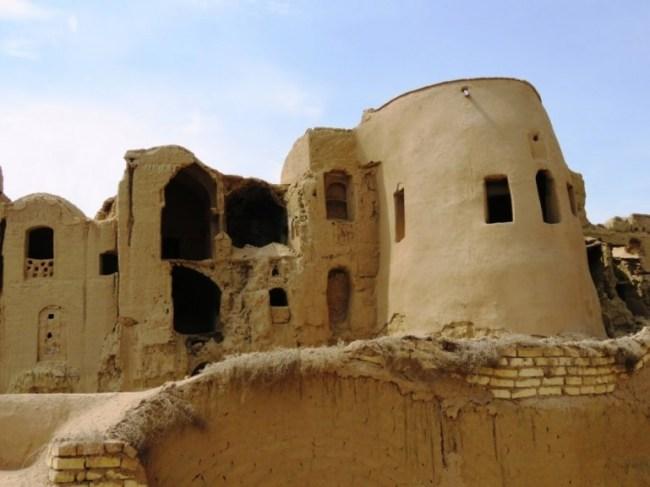 Abandoned mud brick buildings in Kharanaq near Yazd Iran