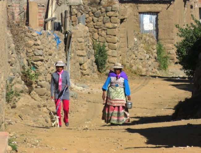 two women in a village in the Colca Canyon