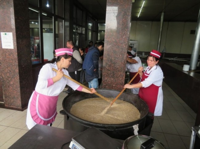 Women stirring Haleem at National Food in Tashkent Uzbekistan