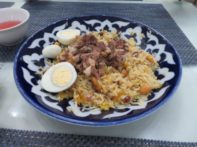 Trying Plov is an experience when backpacking Uzbekistan