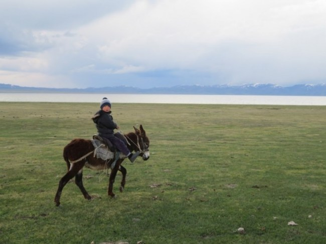 Horse back riding at Song kul lake in Kyrgyzstan