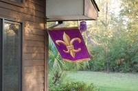 Purple and gold fleur de lis flag