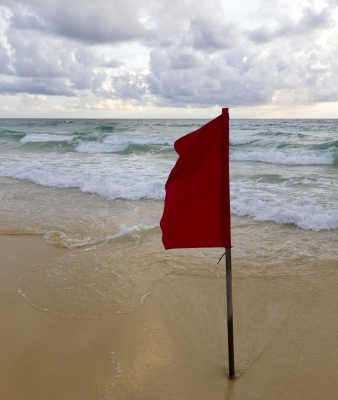 "Red Warning Flag On Beach"" by Stuart Miles"