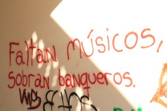 "Reads: ""Faltan musicos, sobran banqueros"" English: Lacking musicians, but a surplus of bankers."