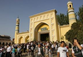 Kashgar's yellow-tiled Id Kah Mosque in Xinjiang, China