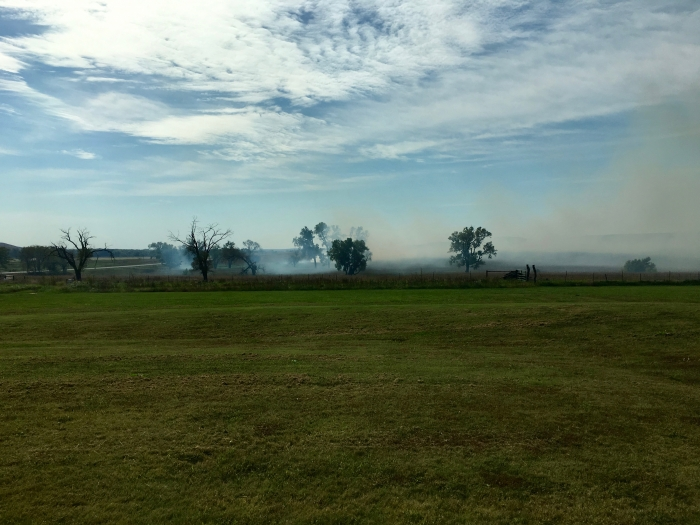 distant prairie grass fire
