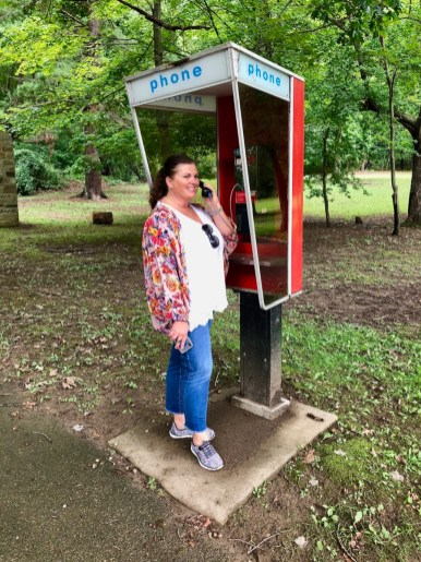 woman using telephone booth