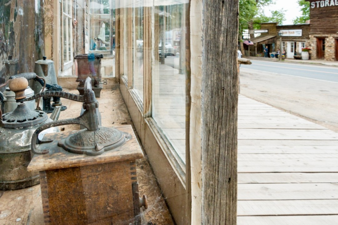 Virginia City Coffee Grinder Window 2 - Two Montana Ghost Towns Where the Old West Comes Alive