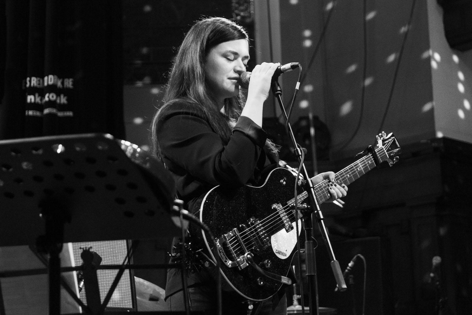 Photo of Siobhan Wilson on stage at Saint Luke's on 3 February 2019
