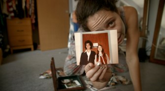 The filmmaker with a picture of her parents
