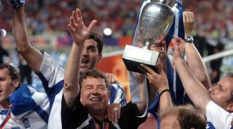 The Greek team lift the trophy