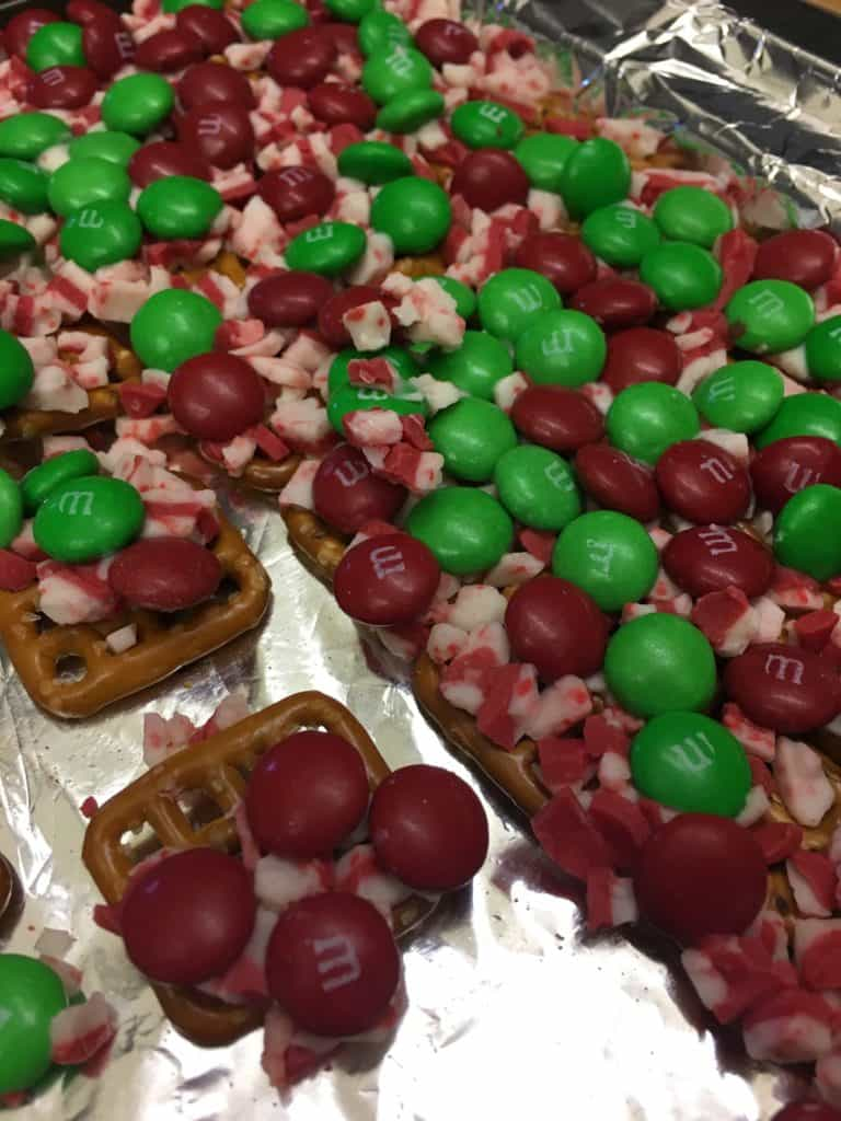 If you're looking for a quick and easy treat to make for your next holiday party, this is the way to go. Pretzels, Rolos, M&M's, and Andes Mints are all you need to make a couple of trays full of a salty sweet treat.