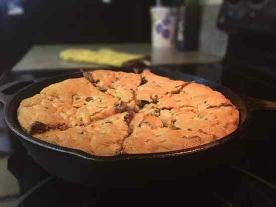 Create a giant chocolate cookie in a cast iron skillet is so easy to make. Mix the ingredients and scoop them into the skillet, and you'll have a delicious treat in no time.