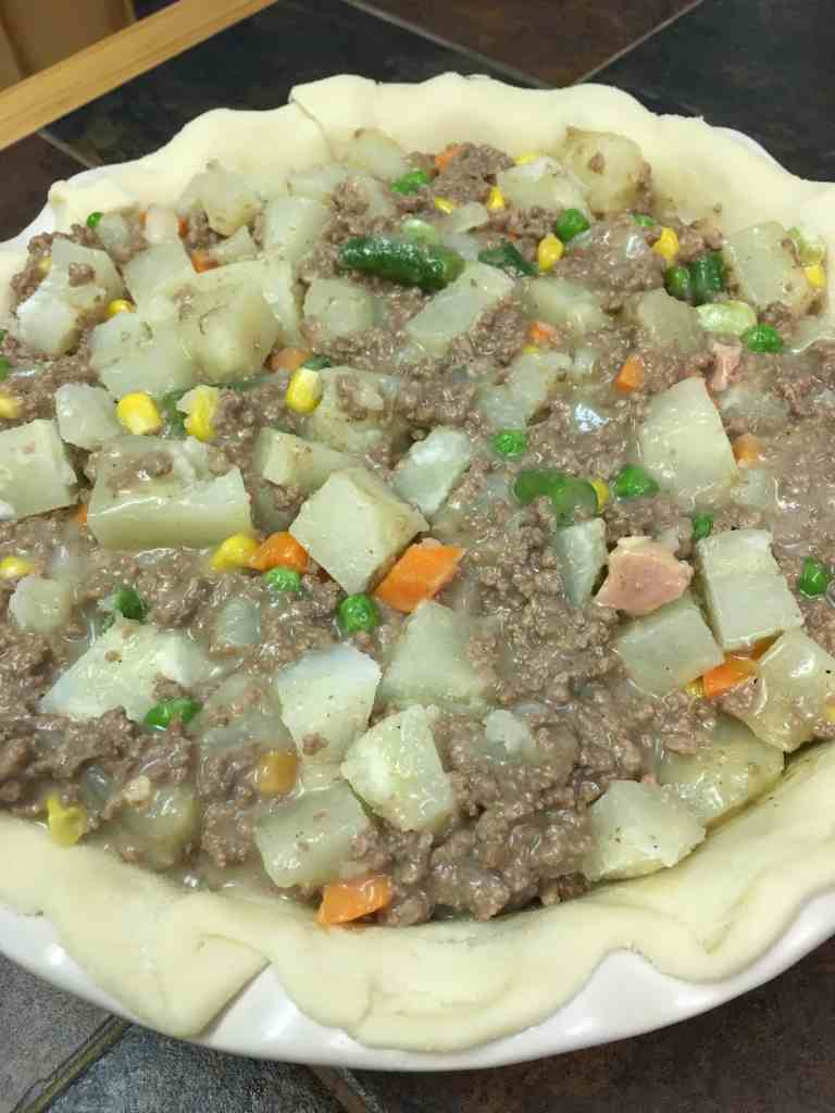 It's easy to make a beef pot pie with frozen ingredients, and two premade pie crusts.