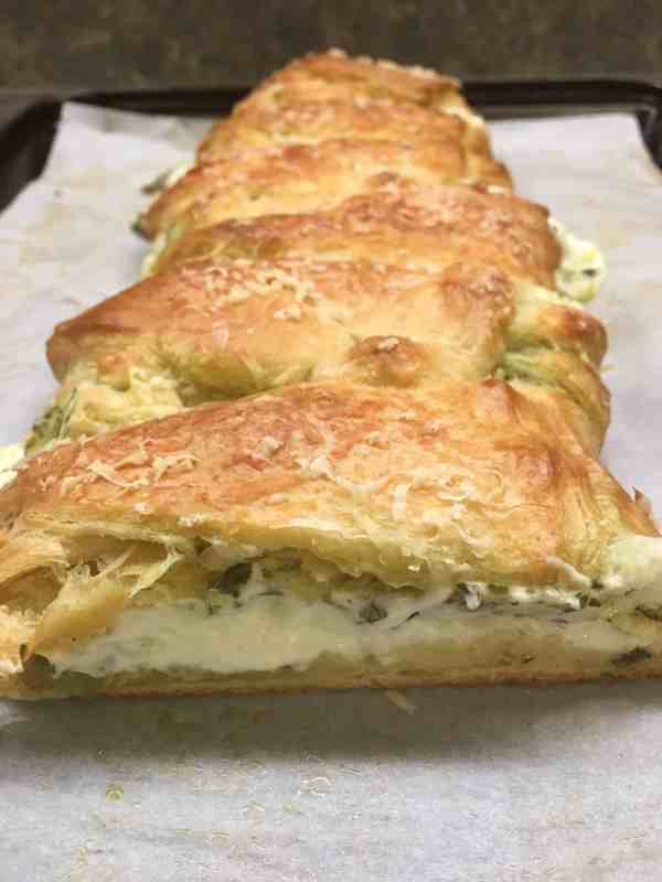 The Cream Cheese Pesto Crescent Roll Braid is a delicious appetizer to make for parties.