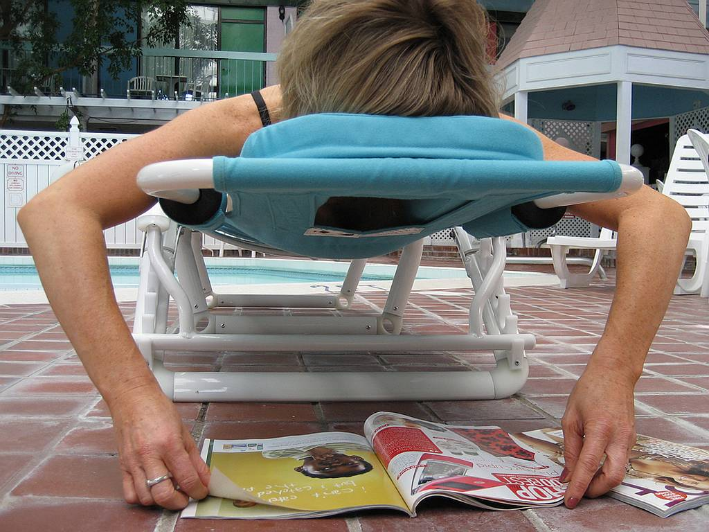 reading poolside lounge chair plush rocker ergonomic takes pain out of lounging